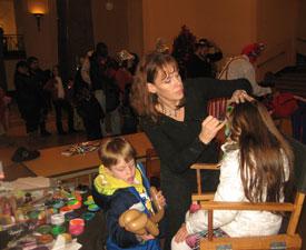 Barb face painting at First Night Alexandria